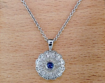 "18 Karat White Gold, Diamond, and Sapphire Pendant, on an 18"" White Gold Chain"