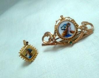 Spilla oro 12 kt con testa di donna su ceramica con 1 smeraldo e 6 perline e orecchino spaiato