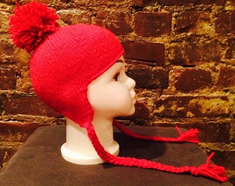 Child's hat with earflaps, tassels and pom pom - fits 2-3 year old child