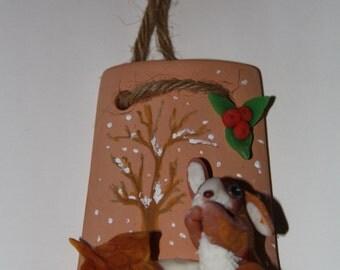 Decorative terracotta shingle representing a bunny