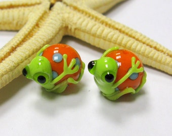 SMAUGGS handmade frog-beads (2p, 17mm x 12mm), glass, orange, green, hole 2mm