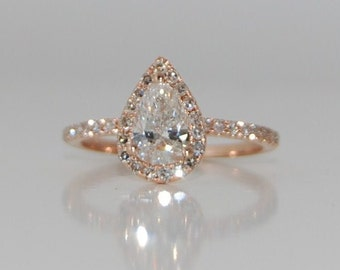 Rose Gold engagement ring. Rose gold diamond ring pear cut diamond ring. 1ct White D/VS2 diamond ring.