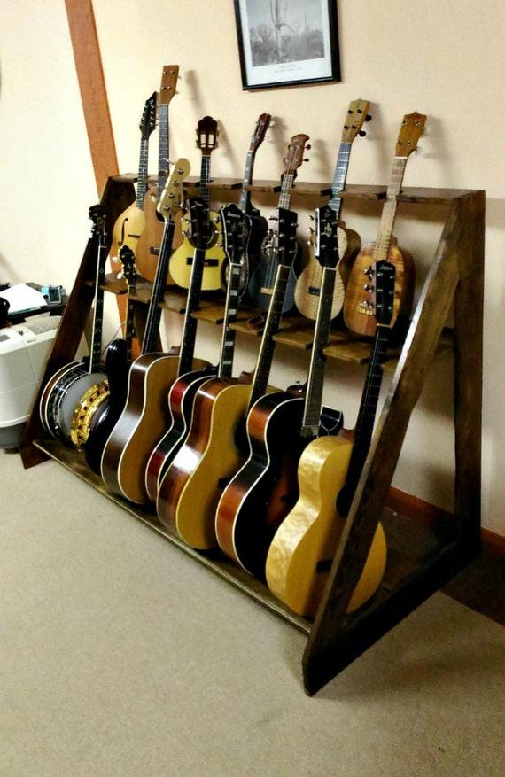 items similar to guitar banjo mandolin ukulele rack from reclaimed barn wood on etsy. Black Bedroom Furniture Sets. Home Design Ideas