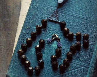 SALE ... Myrddin. Raw Amethyst Crystal Point and Antique Hand Cut Glass Bead Necklace.