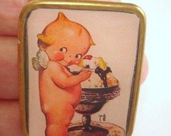 Kewpie Doll Eating Ice Cream Brooch