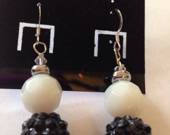 Black and white beaded dangle earrings.