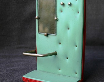 Antique retro mid century mod toy coat rack for the cloakroom of the doll house.