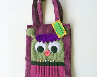 Purple corduroy monster colouring in bag with pencil teeth