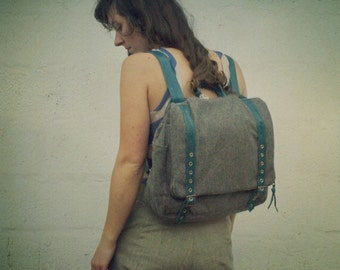 Convertible messenger backpack with teal leather straps