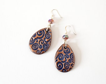 Drop dangle earrings in blue polymer clay and bronze shimmering powders, spirals pattern