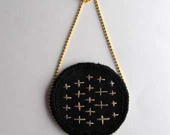 Embroidered gold pendant necklace on black muslin and black felt with gold ball chain textile jewelry