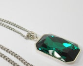 Emerald color Swarovski Crystal in a silverplated brass setting on stainless steel chain