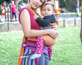 Wrap mei tai baby carrier made from orange flower jacquard and grey linen. Perfect for hot summer.