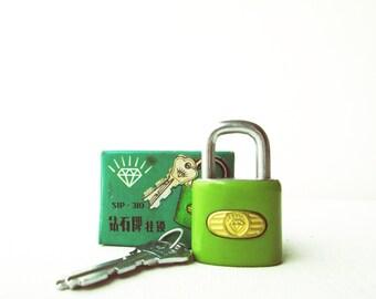 Vintage retro green padlock miniature lock and key