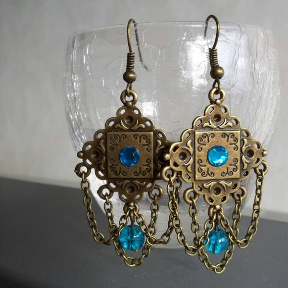 Bronze earrings with chains and blue beads
