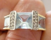 14K gold ring with three large aquamarine and diamonds
