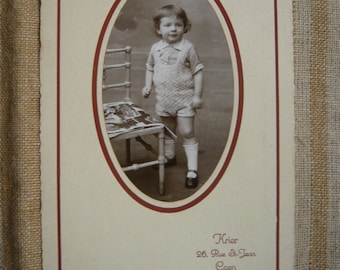Young norman child photography kid in oval pic black white colors circa 1930 childhood family photography  collectible souvenir photography