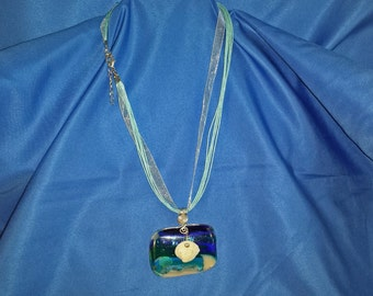 Sterling wire-wrapped ocean pattern bar with mini-shell necklace