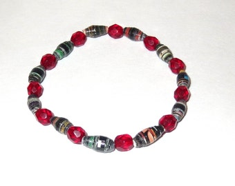 Ruby Red Bracelet made from recycled magazine paper rolled beads and stretch cord.