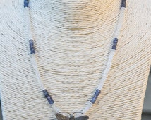 Pretty, delicate necklace with Hill Tribe Silver Butterfly Pendant on a beaded moonstone and iolite chain.