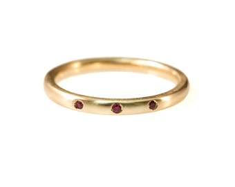 3 Stone Burnished Ruby band in 14kt Gold