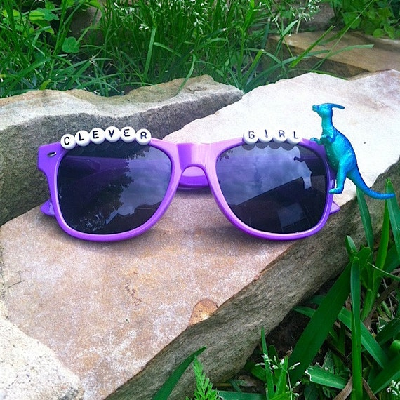 Clever Girl Blue: Jurassic Dinosaur Themed Purple Sunglasses Clever