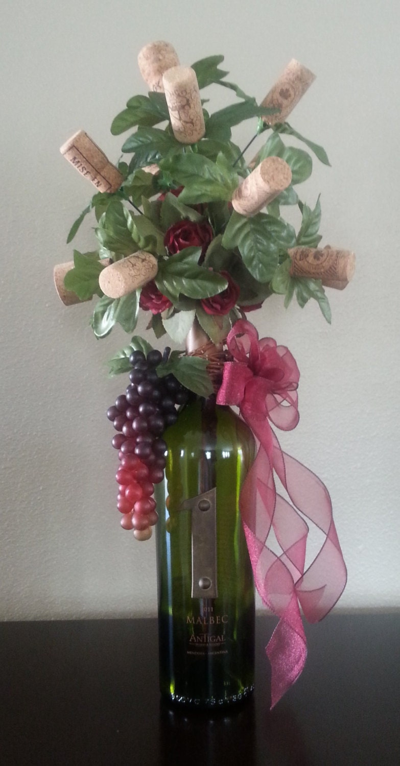 artificial flower arrangement floral wine bottle by