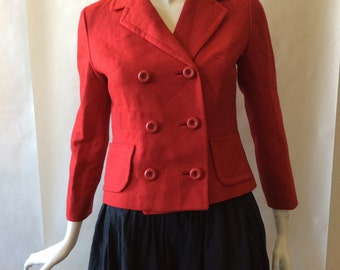 Early 1960's double breasted cranberry red jacket, with round buttons, notched collar, and long sleeves, medium / size 8