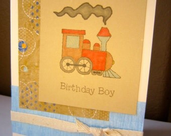 "Multi-Layered Handmade Birthday Boy Train Card with ""Let's Celebrate"" on the inside"