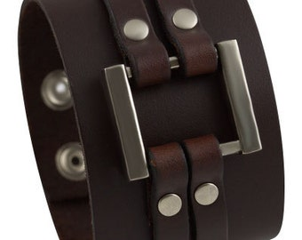 Thick brown handmade leather bracelet with 2 studded strips and a large metal square, adjustable wide leather cuff bracelet
