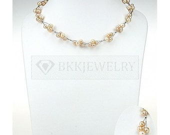 Short necklace of three strands of Japanese silk knitted together with peach colored pearls and beads.