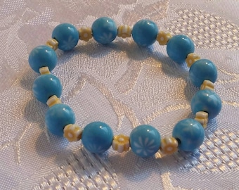 Blue and yellow flower beaded stretch cord bracelet