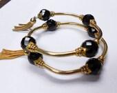 Gold Plated Wrap Bracelet w/ Black Glass Beads & Tassels