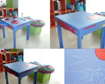 Convertible child table in the kitchenette and slate for chalk.