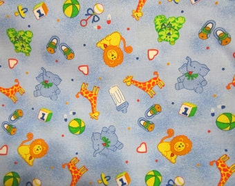 cotton fabric with lions giraffes and elephants for infants