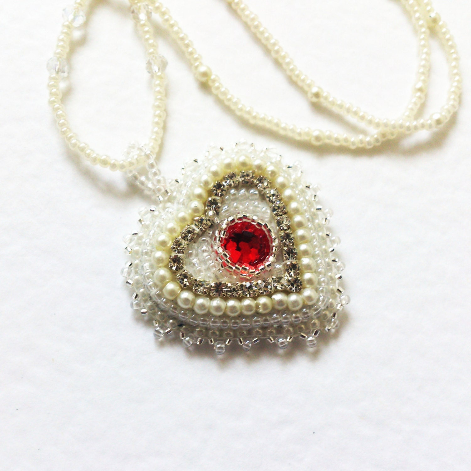 Bead embroidery necklace heart hand by bespokeinnadesign