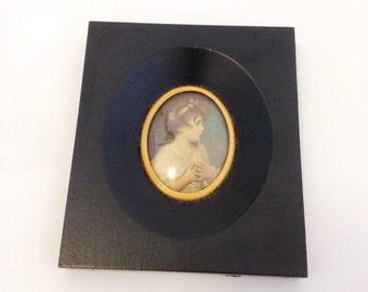 The Age Of Innocence 1847 print in Black Frame. Silhoutte frame Oval picture.