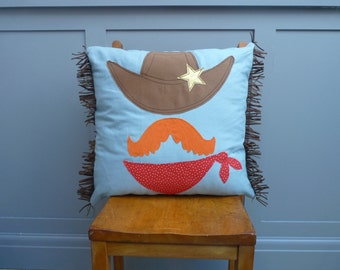 Cushion with appliqued Cowboy , with red polka dot reverse and brown  fringed trim.(Free p&p uk)