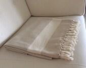 Beige cotton blanket in Herringbone pattern. Perfect as a bedspread, blanket, throw or sofa cover.