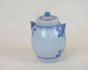 """Blue and white pottery jar, 8""""high, 5 3/4"""" tall, marked on the bottom"""