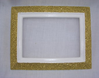 5 x 7 picture and 7.5 x 9.5 frame. White and gold glitter