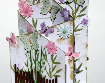 Cascading floral greeting card, with butterflies in a garden feel. Antique look.