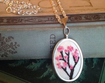 Cherry blossom embroidered silver oval pendant necklace