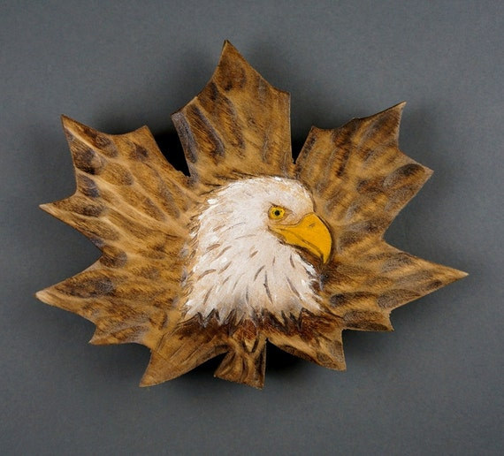 Leaf maple sculpture on wood head of eagle relief color