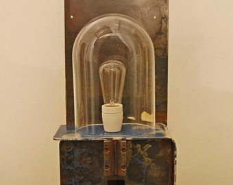 French industrial salvage light, created on the base of a metal worker vice/vise with glass globe, ceramic bulb base