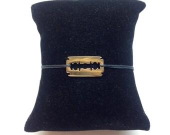 Gold plated razor blade bracelet. Style Dinh Van