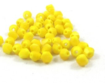 Bead, 165 Beads, Celestial Crystal®, glass, 16-facet, Opaque Yellow, 4mm faceted bicone.