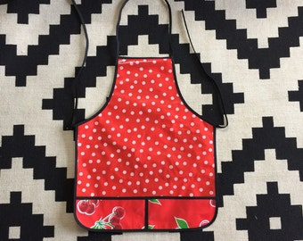 Red oilcloth apron