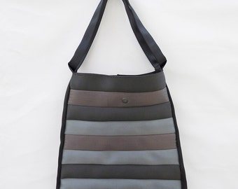Upcycled geometric handbag. Entirerly made with discarded seat belts.