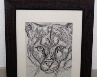 Framed black and gray big cat drawing